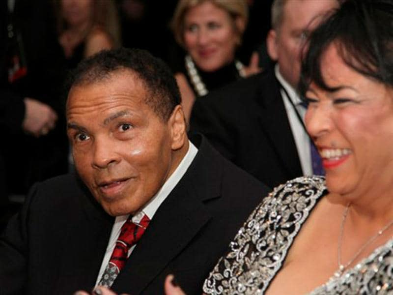 Muhammad Ali , celebrates his 70th birthday next to his sister-in-law, Marilyn Williams, at a fund raiser for the Muhammad Ali Center in his hometown of Louisville, Kentucky. (AP Photo/ The Muhammad Ali Center)