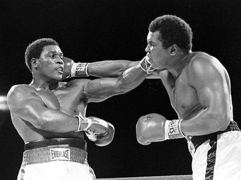 In this Dec 12, 1981, file photo, Trevor Berbick, left, and Muhammad Ali seem to have an equal reach as they slug it out during a heavyweight boxing match on Dec. 12, 1981 in Nassau, Bahamas. Ali turns 70 on January 17, 2012. (AP Photo/File)