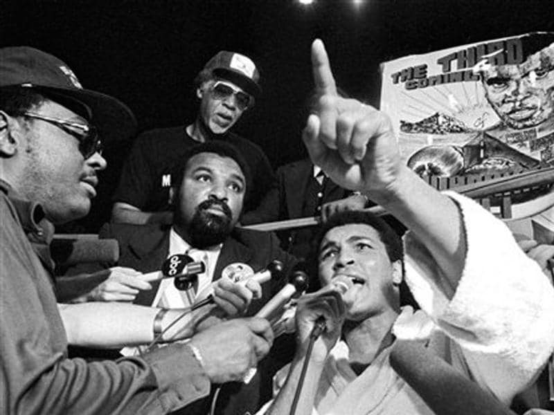 In this September 14, 1978, file photo, Muhammad Ali shouts while someone holds a poster predicting his third coming following his last workout in New Orleans, before attempting to claim the heavyweight title for a third time, against Leon Spinks, at the Superdome. Ali turns 70 on January 17, 2012. (AP Photo/File)