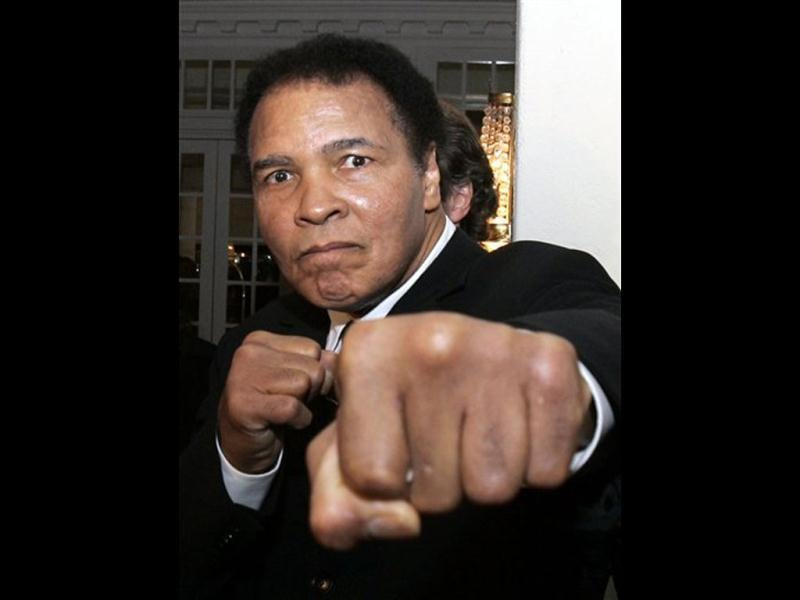 In this January 28, 2006, file photo, former heavyweight boxing champion Muhammad Ali gestures toward photographers in a hotel lobby in Davos, Switzerland. Ali turns 70 on Jan. 17, 2012. (AP Photo/Michel Euler,file)