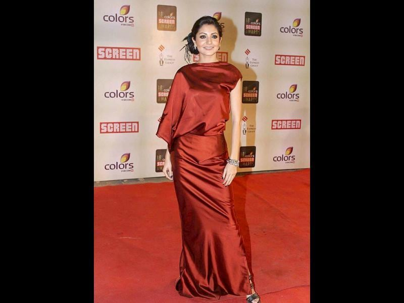 Chic Anushka Sharma in a rust Bibhu Mohapatra creation.