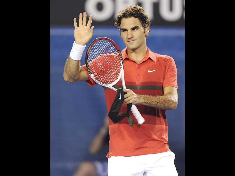 Switzerland's Roger Federer waves to the crowd following his win over Russia's Alexander Kudryavtsev in their first round match at the Australian Open tennis championship, in Melbourne. (AP Photo/Andrew Brownbill)