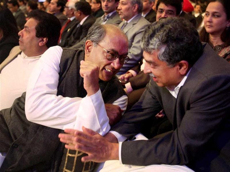 Congress leader Digvijaya Singh shares a light moment with UID chairman Nandan Nilekani during the fifth Ramnath Goenka Excellence in Journalism Awards in New Delhi. PTI Photo