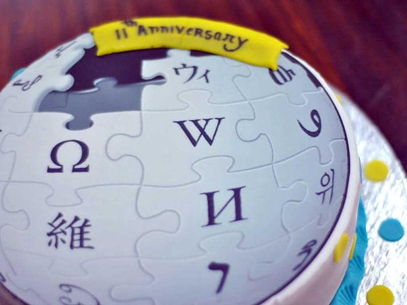 A cake dressed in the logo of Wikipedia to commemorate its 11th anniversary in Delhi.