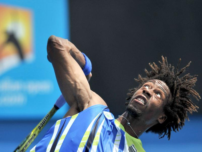 Gaël Monfils of France serves during his men's singles match against Marinko Matosevic of Australia on the second day of the Australian Open tennis tournament in Melbourne on January 17, 2012. AFP PHOTO/NICOLAS ASFOURI