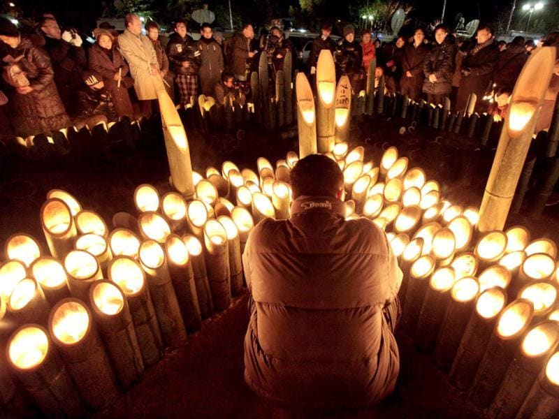 People light candles and pray during a memorial service for the 1995 Hanshin earthquake victims at a park in Kobe, Hyogo prefecture, western Japan. The seventeenth anniversary of the 1995 massive earthquake which killed more than 6,400 people was held in Kobe. AFP PHOTO/JIJI PRESS