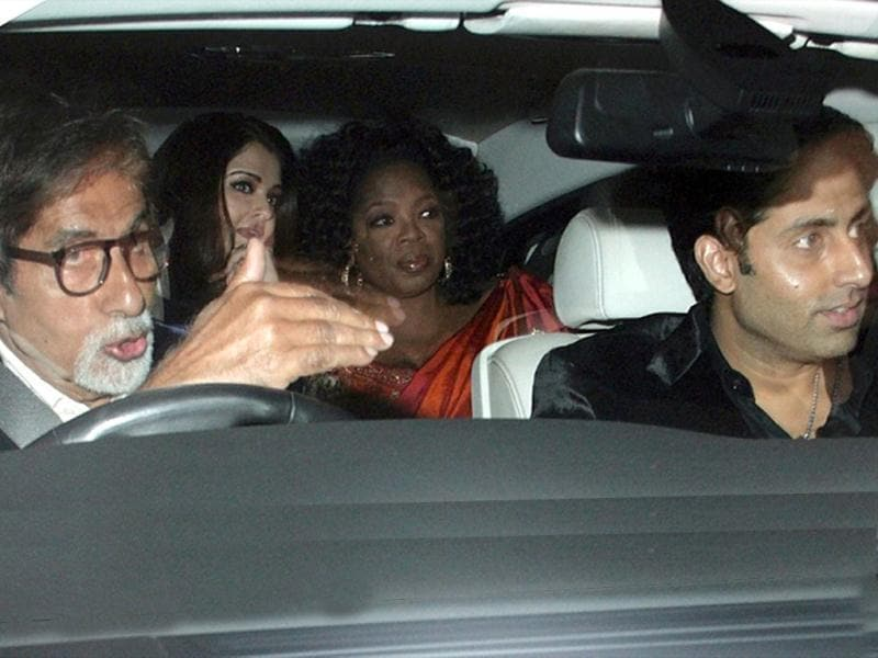 Aishwarya Rai Bachchan, Amitabh Bachchan, Abhishek Bachchan with Oprah Winfrey arrives at the bash on Jan 16 in Mumbai.