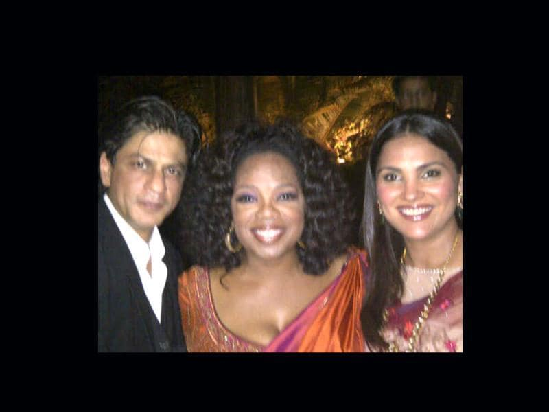 Media mogul Oprah Winfrey poses with Shah Rukh Khan and Lara Dutta and the creme de la creme in a party hosted by socialite Parmeshwar Godrej in Mumbai.