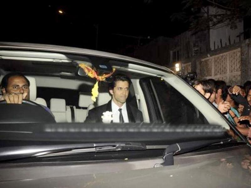 Actor Hrithik Roshan seen in a black suit.