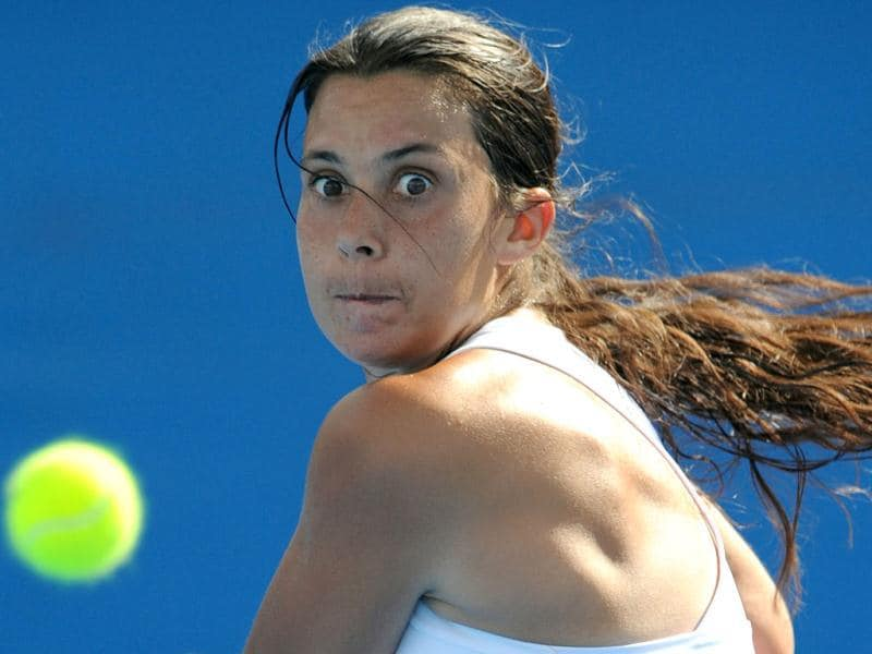 Marion Bartoli of France eyes a return against Virginie Razzano of France in their first round women's singles match on day two of the 2012 Australian Open tennis tournament in Melbourne. Bartoli won 7-5, 6-0. (AFP Photo)