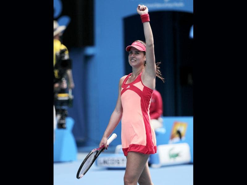 Romania's Sorana Cirstea waves to the crowd after defeating Australia's Samantha Stosur in their first round match at the Australian Open tennis championship, in Melbourne, Australia. (AP Photo)