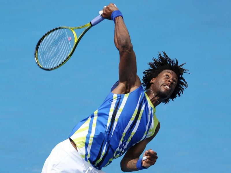 Gaël Monfils of France watches the ball as he serves during his men's singles match against Marinko Matosevic of Australia on the second day of the Australian Open tennis tournament in Melbourne. Monfils won 7-6. 6-3. 6-3 . (AFP Photo)