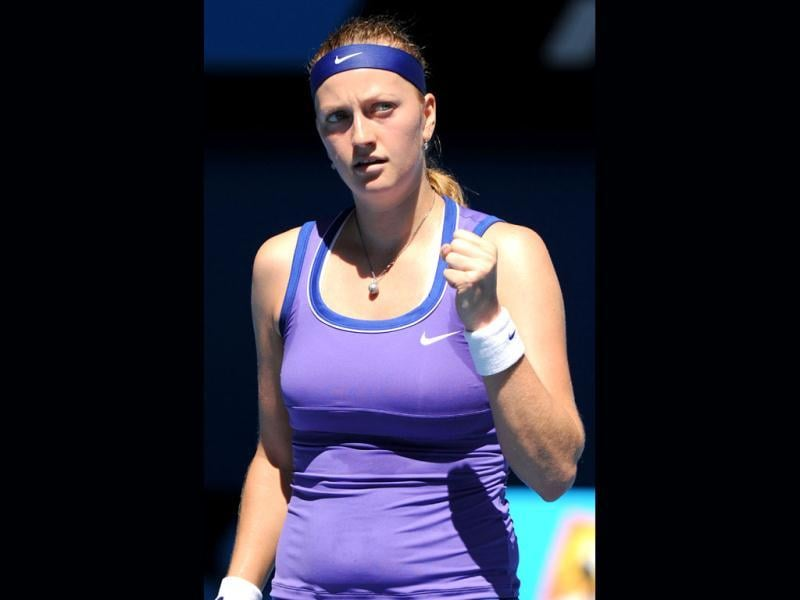 Petra Kvitova of the Czech Republic celebrates winning a point against Vera Dushevina of Russia in their first round women's singles match on day two of the 2012 Australian Open tennis tournament in Melbourne.(AFP Photo)
