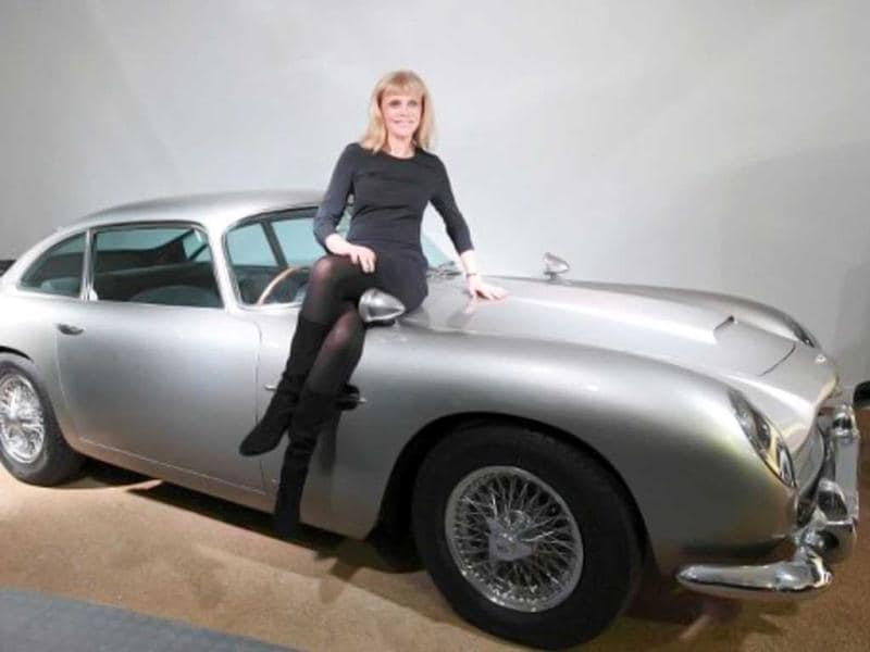 Swedish actress Britt Ekland poses on the Aston Martin DB5 car used in the 1964 James Bond film Goldfinger on display at the Bond in Motion exhibition at the Beaulieu National Motor Museum at Brockenhurst in the southern English county of Hampshire. AFP photo