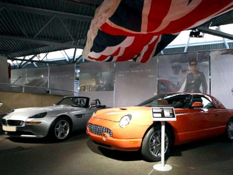 The BMW Z8 (L) from the 1999 James Bond film The World Is Not Enough is parked next to the Ford Thurderbird used in the 2002 Bond film Die Another Day at the Bond in Motion exhibition in the southern English county of Hampshire. AFP photo