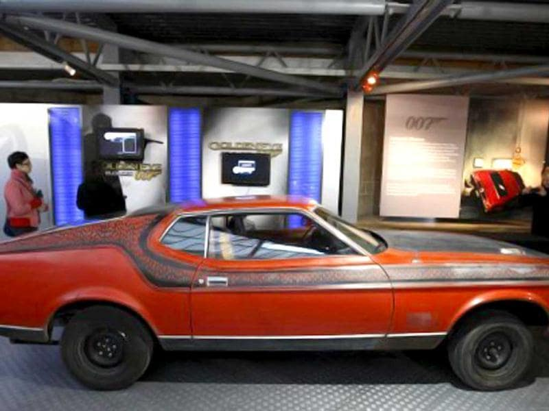 Visitors look at the Ford Mustang Mach 1, featured in the 1971 James Bond film Diamonds Are Forever, at the Bond in Motion exhibition at the Beaulieu National Motor Museum at Brockenhurst in the southern English county of Hampshire. AFP photo