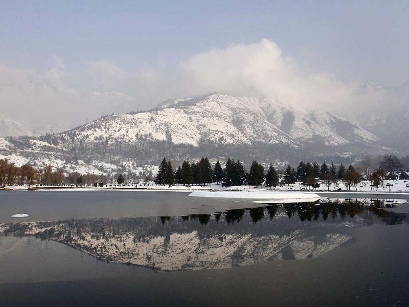 Snow-covered Zabarwan mountains are reflected in the waters of a local garden in Srinagar, Kashmir Valley. AP Photo/Mukhtar Khan