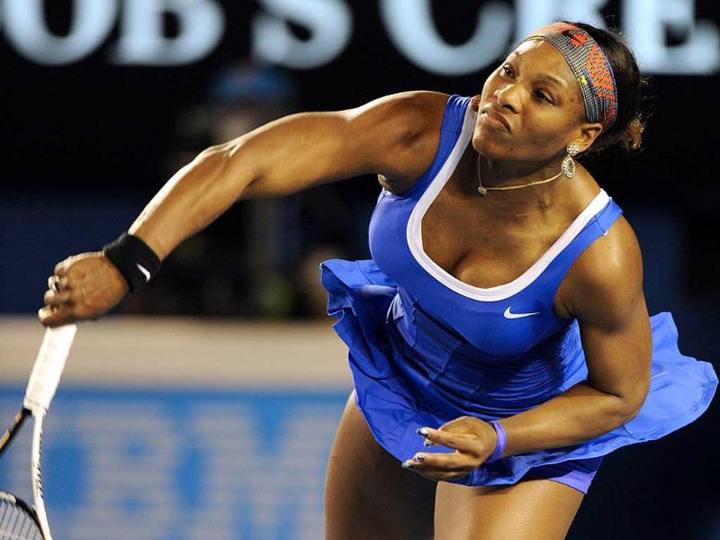 Serena Williams of the US serves against Tamira Paszek of Austria in their first round women's singles match on day two of the 2012 Australian Open tennis tournament in Melbourne. AFP Photo/Greg Wood