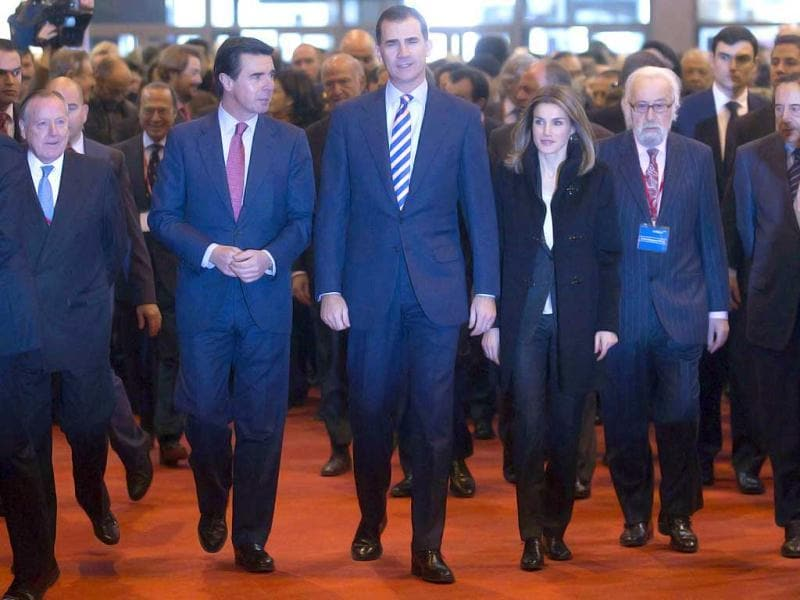 Spanish Crown Prince Felipe (3rd L), Princess Letizia (3rd R) and Spanish industry, commerce and tourism minister Jose Manuel Soria (2nd L) arrive at the International Tourism Trade Fair (FITUR) on its inauguration day in Madrid. Reuters photo