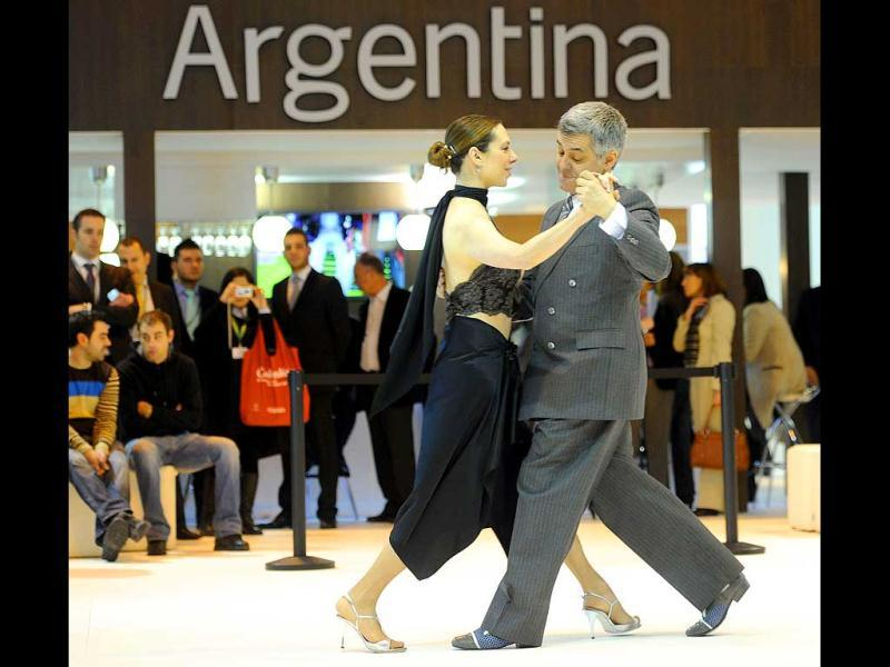 Tango dancers perform in front of the Argentinian stand during the inauguration of the International Tourism Trade Fair in Madrid. AFP photo