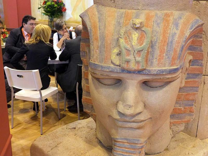 People sit at the Egyptian stand during the inauguration of the International Tourism Trade Fair in Madrid. AFP photo