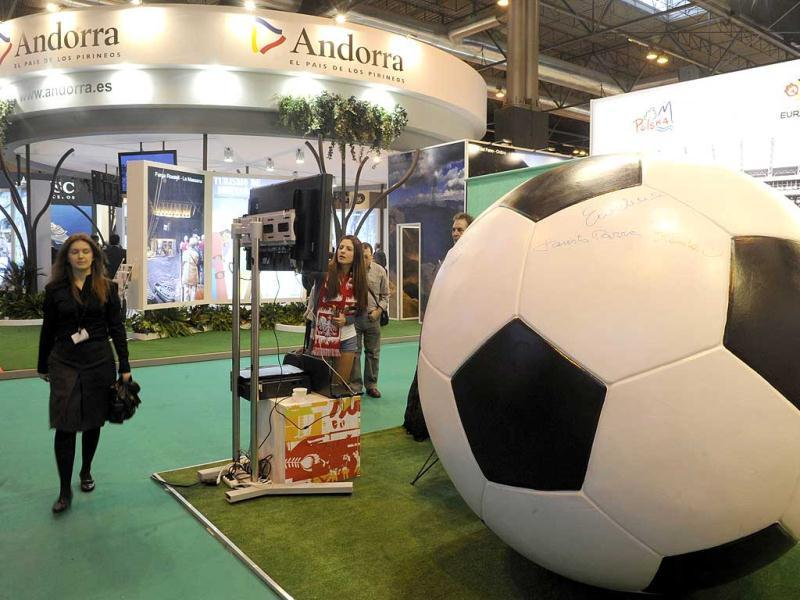 A giant soccer ball is pictured at the Polish stand during the inauguration of the International Tourism Trade Fair in Madrid. Delegations will attend the 32th edition of the fair to promote each country's tourist industry. Poland and Ukraine will host the EURO 2012 football competition from June 8 to July 1, 2012. AFP photo