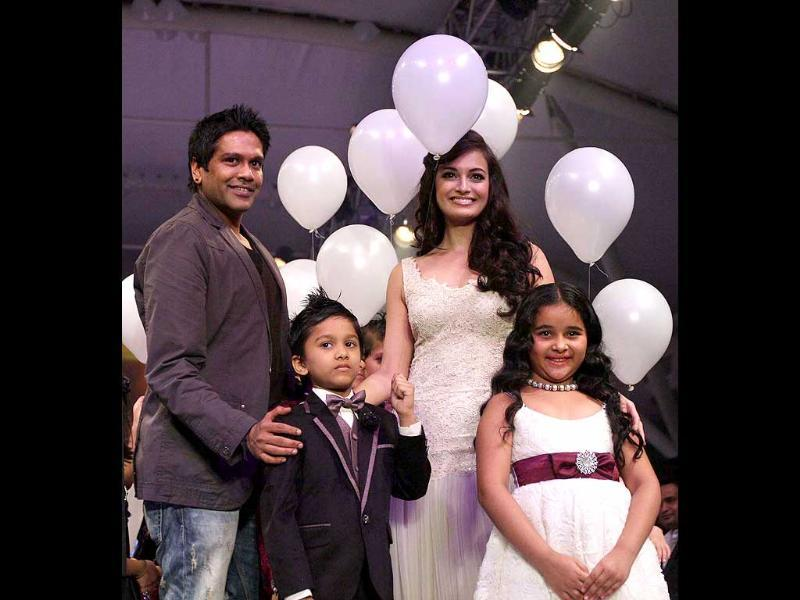 Bollywood actress Dia Mirza along with designer Rocky S and kids strikes a pose during the India Kids Fashion Week 2012, in Mumbai.