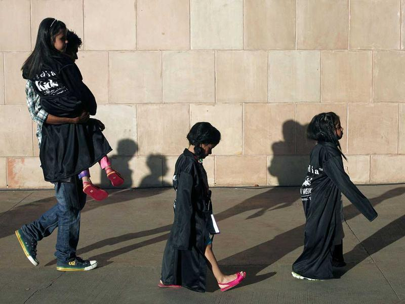 Child models walk towards the green room before a show at India Kids Fashion Week in Mumbai. Reuters/Danish Siddiqui.