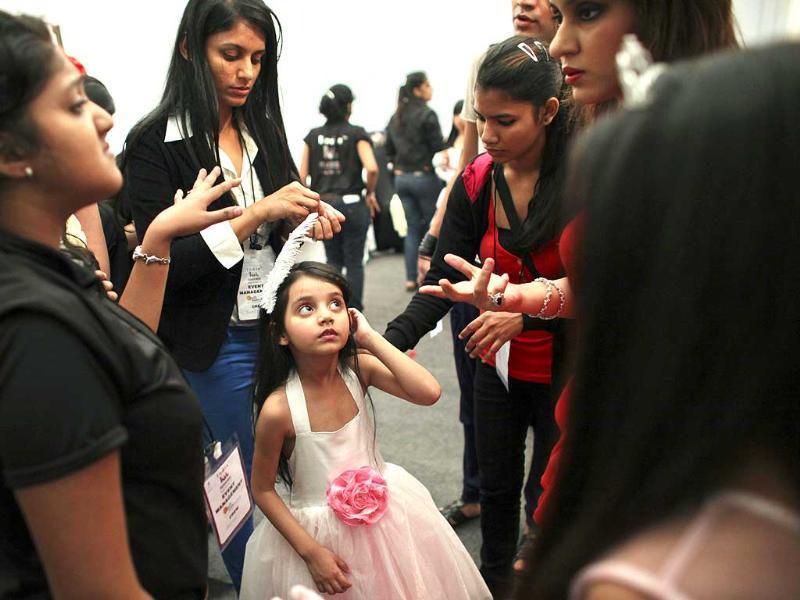 A child model receives directions backstage before a show at India Kids Fashion Week in Mumbai. Reuters/Danish Siddiqui.