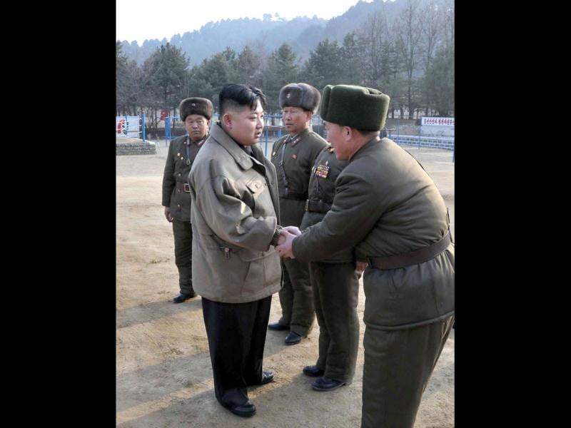 This undated picture, released by North Korea's official Korean Central News Agency, shows new North Korean leader Kim Jong Un (C) inspecting the Korean People's Army Unit 169 honoured with the title of the O Jung Hup-led Seventh Regiment at an undisclosed location in North Korea. AFP Photo / KCNA via KNS