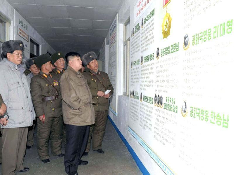 In this undated photo released by the Korean Central News Agency and distributed in Tokyo by the Korea News Service, North Korean leader Kim Jong Un, has a small talk at an undisclosed location in North Korea. KCNA reported he was inspecting a military unit. AP Photo/Korean Central News Agency via Korea News Service