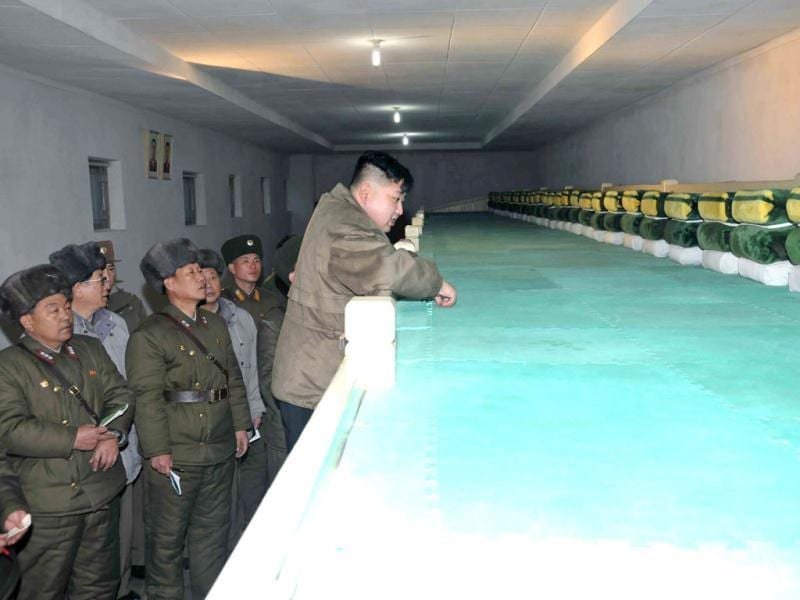 This undated picture, released by North Korea's official Korean Central News Agency shows new North Korean leader Kim Jong Un (C) inspecting the Korean People's Army Unit 169 honoured with the title of the O Jung Hup-led Seventh Regiment at an undisclosed location in North Korea. AFP Photo / KCNA via KNS