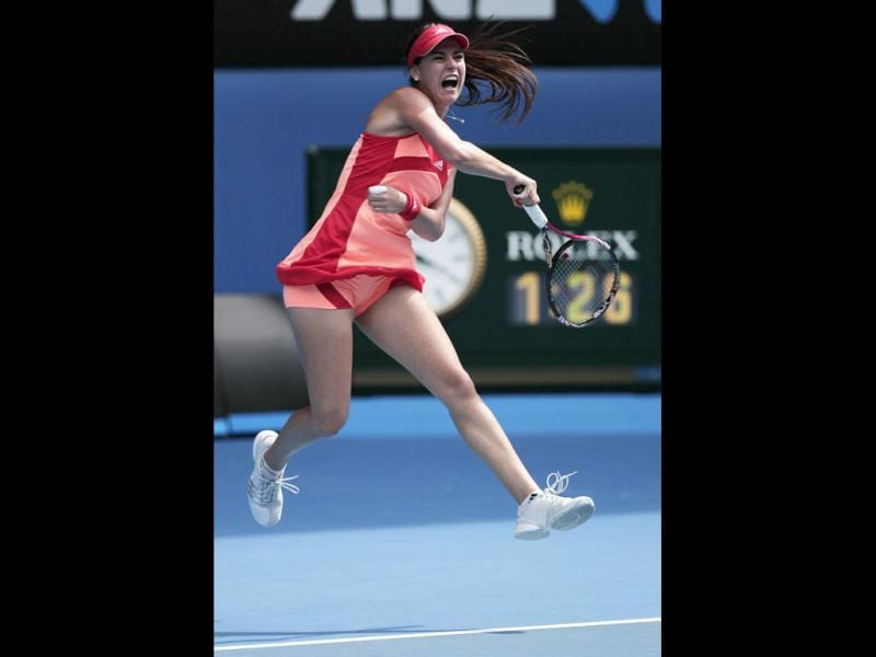 Romania's Sorana Cirstea hits a forehand return to Australia's Samantha Stosur in their first round match at the Australian Open tennis championship, in Melbourne, Australia. (AP Photo)