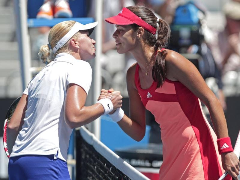 Serbia's Ana Ivanovic, right, and Michaella Krajicek of the Netherland's exchange kisses at the net following their second round match at the Australian Open tennis championship, in Melbourne, Australia. (AP Photo)