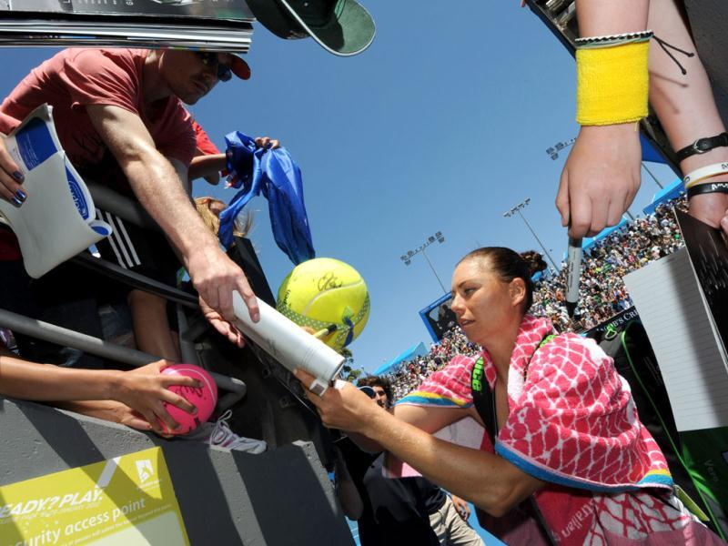 Vera Zvonareva of Russia signs autographs for supporters after victory in her women's singles match against Lucie Hradecka of Czech Republic on the fourth day of the Australian Open tennis tournament in Melbourne. Zvonereva won 6-1. 7-6.. (AFP Photo)