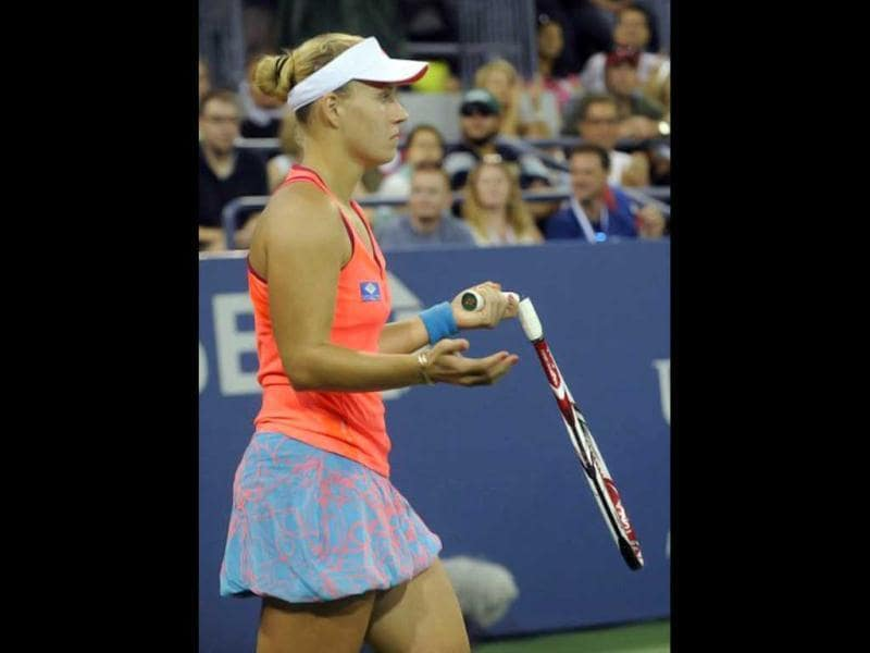 Unseeded Angelique Kerber of Germany shows her broken racket after returning a shot to Samantha Stosur of Australia (9) during a Women's semifinal match at the US Open tennis tournament September 10, 2011 at the Billie Jean King National Tennis Center in New York. AFP