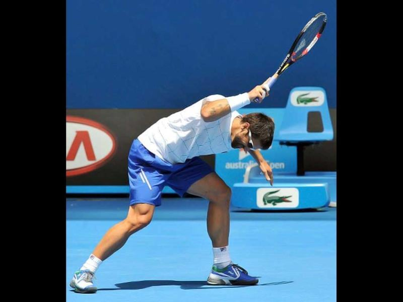 Janko Tipsarevic of Serbia smashes his racket in frustration during a training session ahead of the 2012 Australian Open tennis tournament in Melbourne on January 14, 2012. The tennis season's first Grand Slam of the year will take place from January 16 to 29. AFP