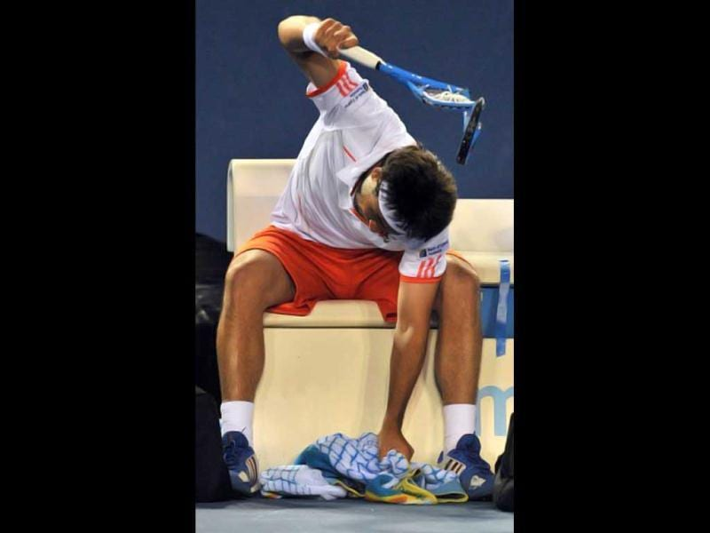 Marcos Baghdatis of Cyprus smashes an already destroyed racket in frustration during a break against Stanislas Wawrinka of Switzerland in their second round men's singles match on day three of the 2012 Australian Open tennis tournament in Melbourne on January 18, 2012. AFP