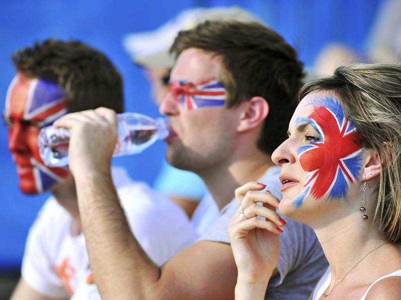 Fans with the Union Flag painted on their faces watch on court eleven which hosted three British hopefuls on the first day of the Australian Open tennis tournament in Melbourne. Reuters/Toby Melville