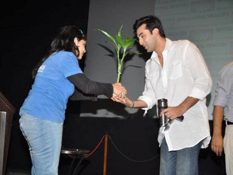 Ranbir Kapoor went for a simple look in a white shirt and denims.