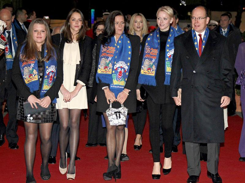 Prince Albert II of Monaco (R) arrives with (L-R) Princess Stephanie's daughters Camille and Pauline, Princess Stephanie and Princess Charlene to attend the opening ceremony of the 36th International Circus Festival of Monte Carlo in Monaco. Reuters/Eric Gaillard
