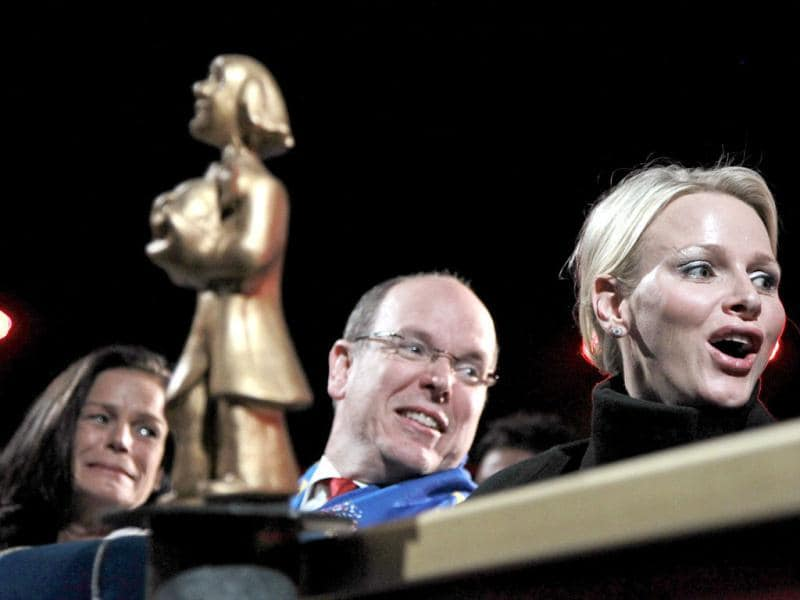 Prince Albert II of Monaco (C) and his wife Princess Charlene (R) react as they attend the opening ceremony of the 36th International Circus Festival of Monte Carlo with Princess Stephanie in Monaco. Reuters/Eric Gaillard