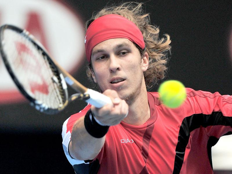 Lukas Lacko of Slovakia hits a return against Rafael Nadal of Spain in their third round men's singles match on day five of the 2012 Australian Open tennis tournament in Melbourne. (AFP Photo)