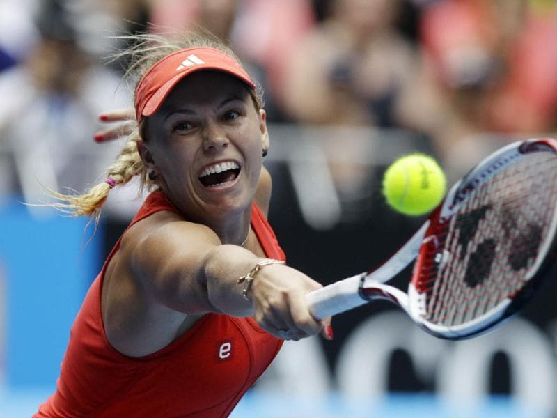 Denmark's Caroline Wozniacki reaches for a backhand return to Romania's Monica Niculescu during their third round match at the Australian Open tennis championship, in Melbourne, Australia. (AP Photo)