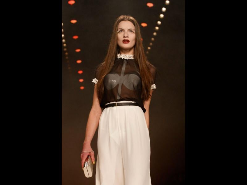 A wedding outfit inspired by lingerie used for the first night made a splash on the catwalk at the Berlin Fashion Week.