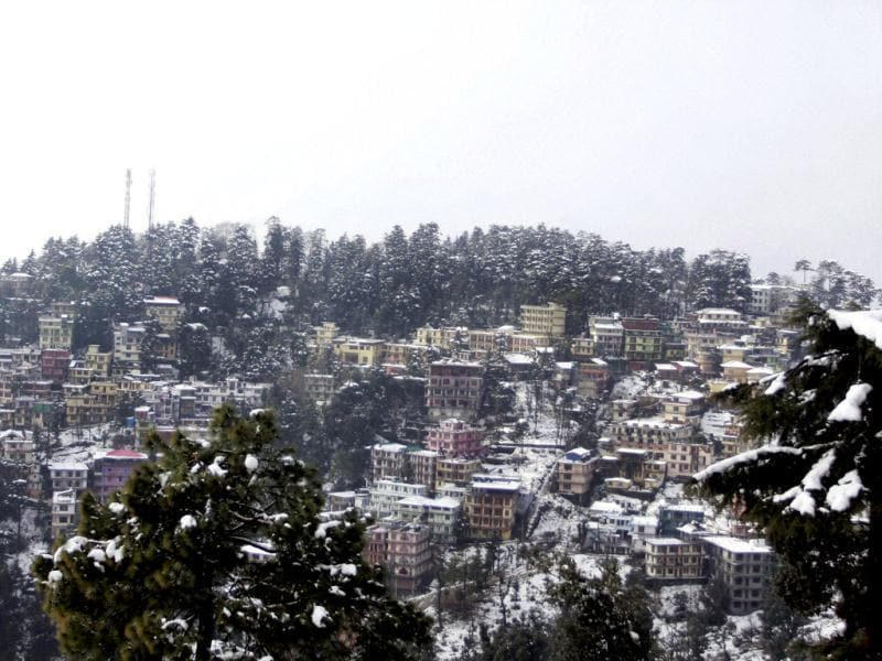 An aerial view of Dharamshala town draped in snow after heavy snowfall in Himachal Pradesh. PTI