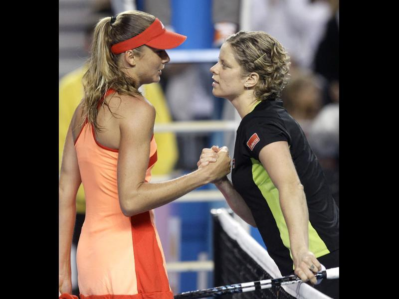 Kim Clijsters of Belgium, right, shakes hands with Daniela Hantuchova of Slovakia at the net, after winning their third round match at the Australian Open tennis championship, in Melbourne, Australia. (AP Photo/Rick Rycroft)