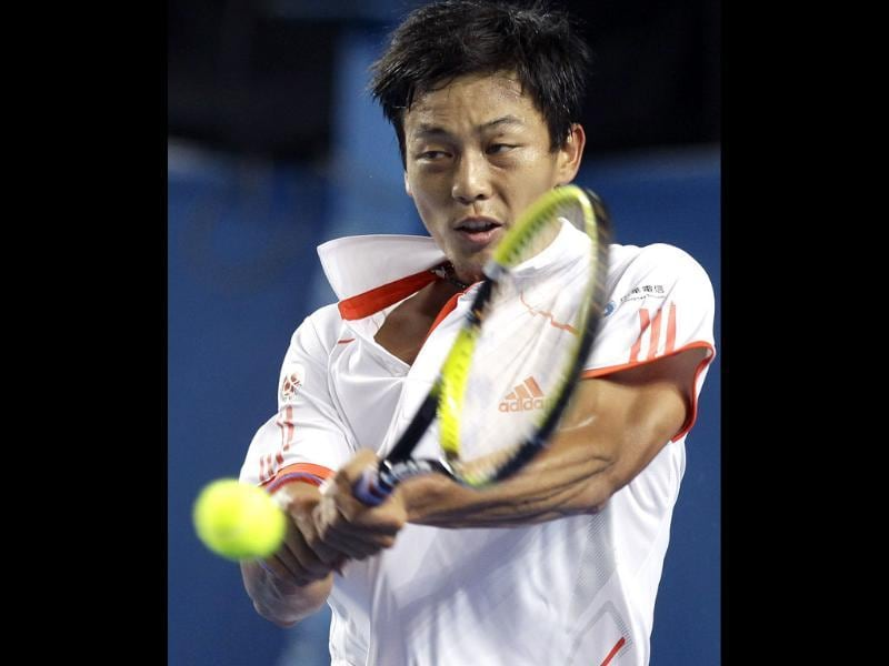Lu Yen-Hsun of Taiwan makes a return to Juan Martin del Potro of Argentina during their third round match at the Australian Open tennis championship, in Melbourne, Australia. (AP Photo/Rick Rycroft)