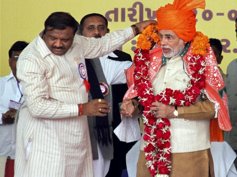 Gujarat chief minister Narendra Modi is garlanded during his Sadbhavana Mission fast in Godhra. PTI photo