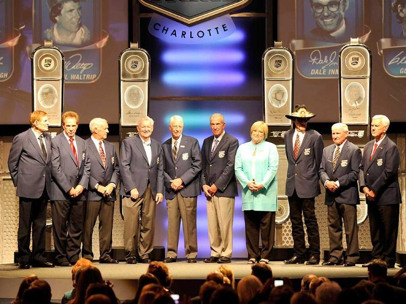 Members of the NASCAR Hall of Fame stand on stage during the 2012 NASCAR Hall of Fame induction ceremony at the Charlotte Convention Center in Charlotte, North Carolina. John Harrelson/Getty Images/AFP